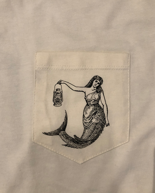 white printed pocket of a t-shirt with a mermaid